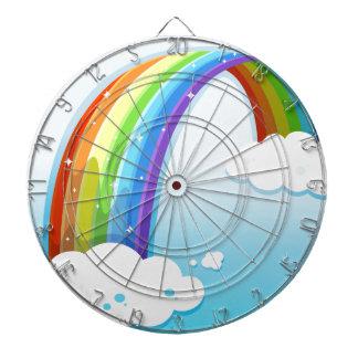 A sky with a sparkling rainbow dartboard with darts