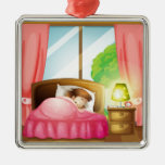 A sleeping girl on a bed metal ornament