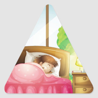A sleeping girl on a bed triangle sticker