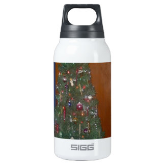 A Small Artificial Christmas Tree with Insulated Water Bottle