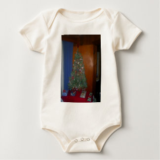 A Small Artificial Christmas Tree with Presents Baby Bodysuit
