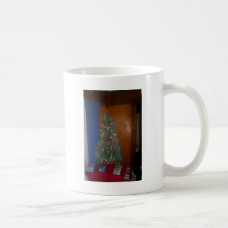 A Small Artificial Christmas Tree with Presents Coffee Mug