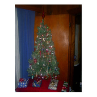 A Small Artificial Christmas Tree with Presents Postcard