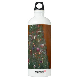 A Small Artificial Christmas Tree with Water Bottle