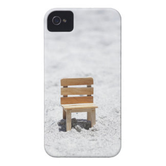 A small chair in the sandy beach iPhone 4 cover