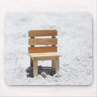 A small chair in the sandy beach mouse pad