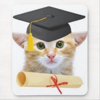 A small kitten wearing graduation hat mouse pad