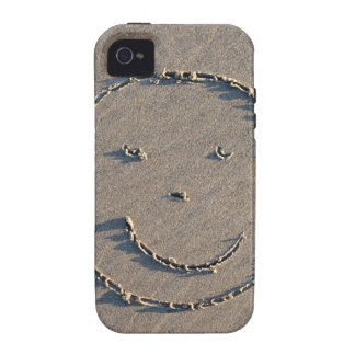 A smiley face drawn in sand. Case-Mate iPhone 4 cover