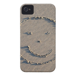 A smiley face drawn in sand. iPhone 4 case