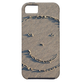 A smiley face drawn in sand. iPhone 5 cover