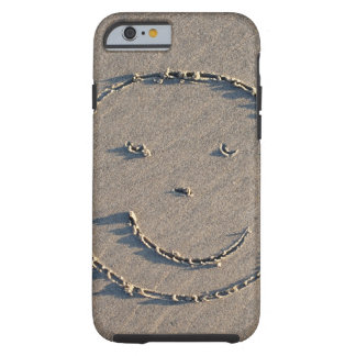 A smiley face drawn in sand. tough iPhone 6 case