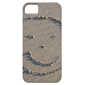 A smiley face drawn in sand. iPhone 5 case