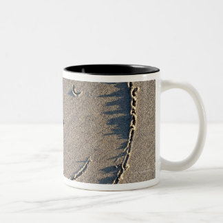 A smiley face drawn in sand. Two-Tone coffee mug