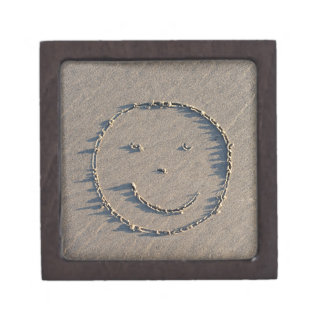 A smiley face drawn in sand. premium trinket boxes