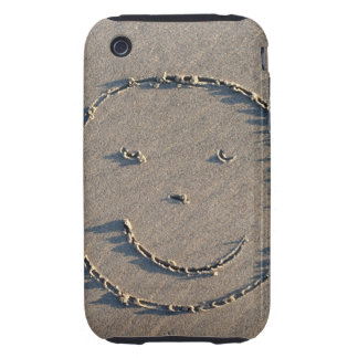 A smiley face drawn in sand. tough iPhone 3 cover