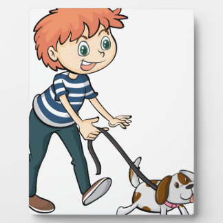 A smiling boy and a dog plaque