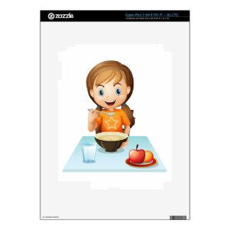 A smiling girl eating her breakfast iPad 3 skins
