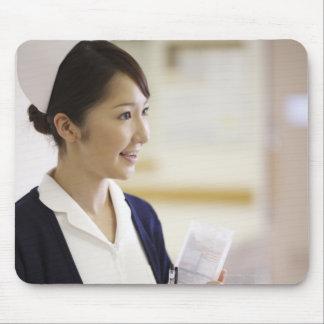 A smiling nurse mouse pad