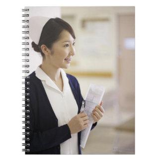A smiling nurse notebook