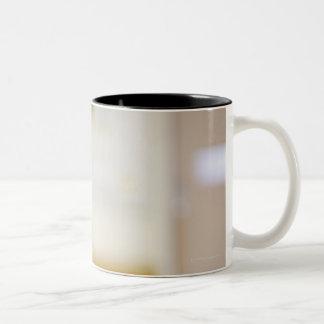 A smiling nurse Two-Tone coffee mug