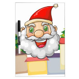 A smiling Santa hugging the village Dry-Erase Board