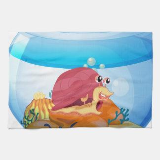 A snail inside an aquarium hand towels