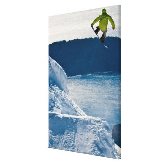 A snowboarder jumping canvas print