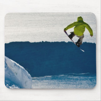 A snowboarder jumping mouse pad