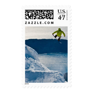 A snowboarder jumping postage
