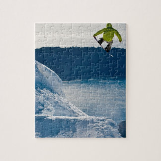 A snowboarder jumping jigsaw puzzle