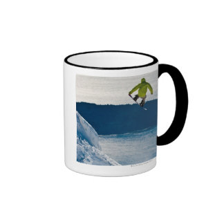 A snowboarder jumping ringer coffee mug
