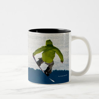 A snowboarder jumping Two-Tone coffee mug