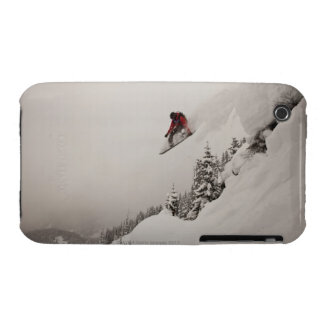 A snowboarder jumps off a cliff into powder in iPhone 3 Case-Mate case