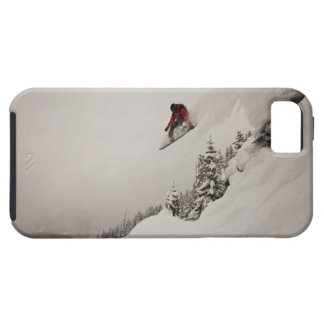 A snowboarder jumps off a cliff into powder in iPhone 5 cases