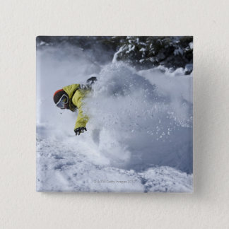 A snowboarder rips untracked powder turns in 2 button