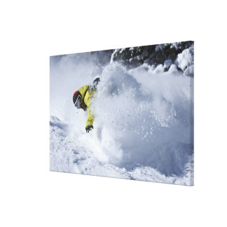 A snowboarder rips untracked powder turns in 2 canvas print