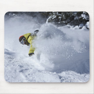 A snowboarder rips untracked powder turns in 2 mouse pad