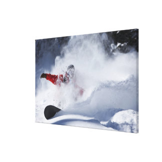 A snowboarder rips untracked powder turns in canvas print