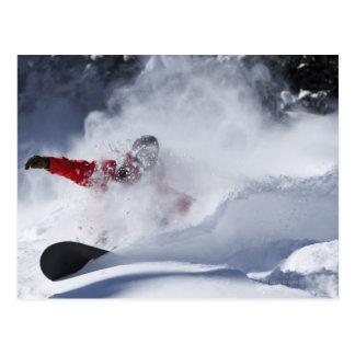 A snowboarder rips untracked powder turns in postcard