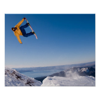 A snowboarder spins off a jump in Argentina Poster