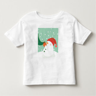 A snowman hanging an ornament on a tree toddler t-shirt