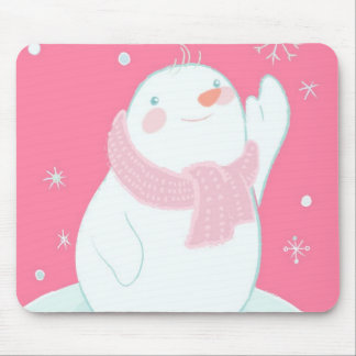 A snowman reaching for a falling snowflake mouse pad