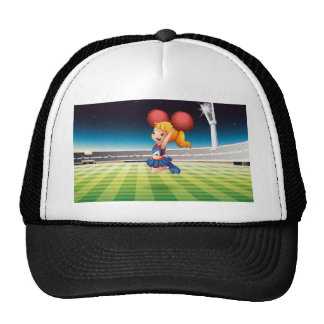 A soccer field with an energetic cheerdancer trucker hat