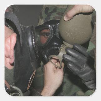 A solder assists a Marine Square Sticker