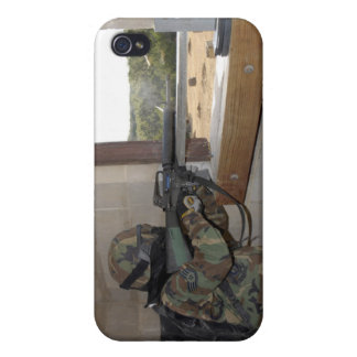 A soldier acts as an opposition force covers for iPhone 4