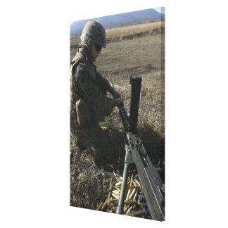A soldier changes the barrel of an M2 50 Canvas Print