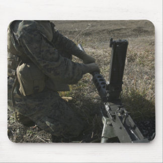 A soldier changes the barrel of an M2 50 Mouse Pad