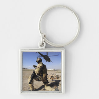 A soldier conducts security for an HH-60 Keychain
