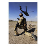 A soldier conducts security for an HH-60 Poster