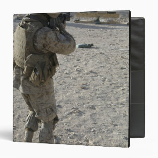 A soldier engages his target on a shooting rang 3 ring binder
